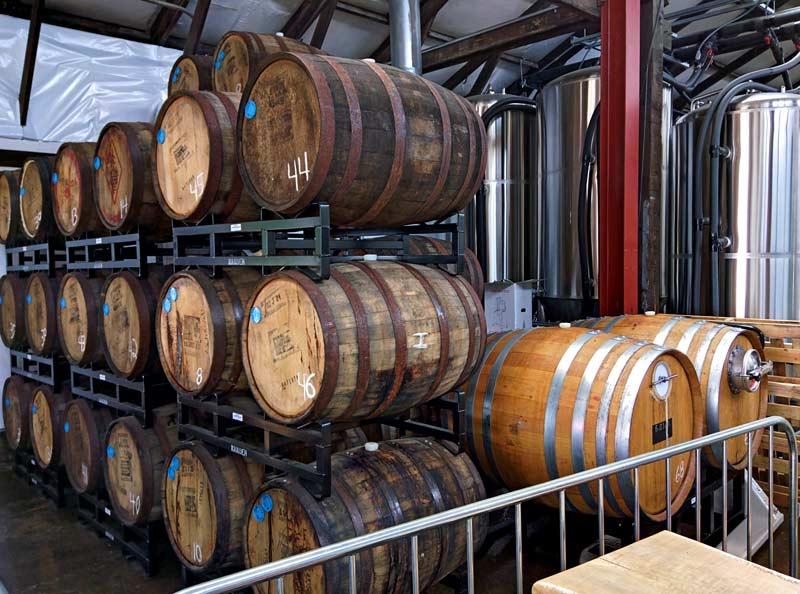 oak barrels at wander brewing